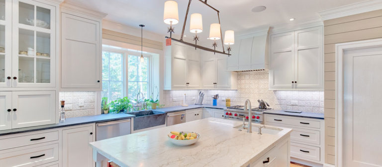 A white marble kitchen with custom lighting